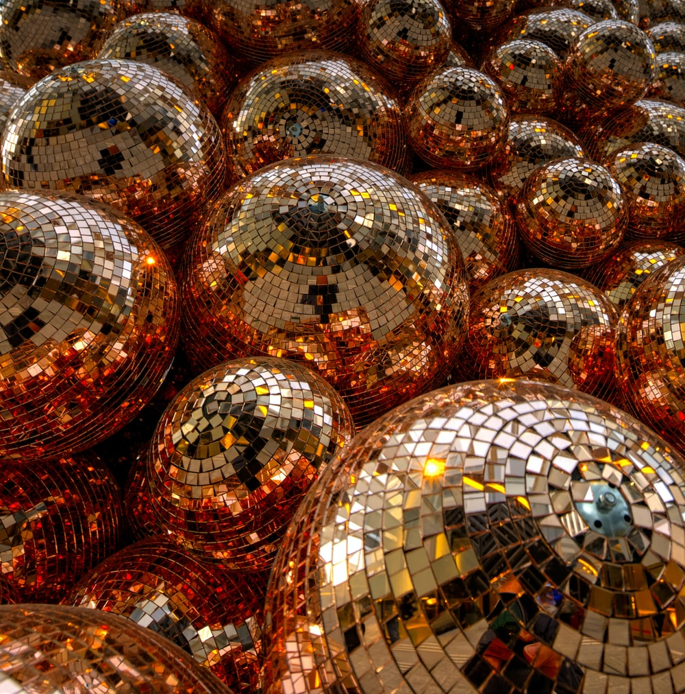 clear glass ball on brown and white textile
