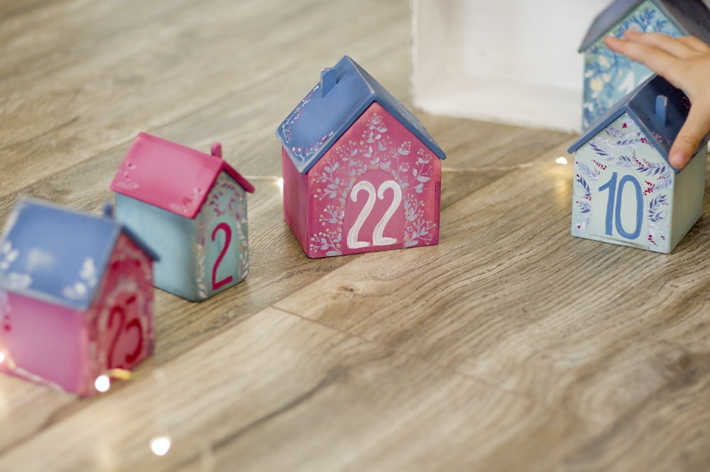 red and white ceramic house on brown wooden table