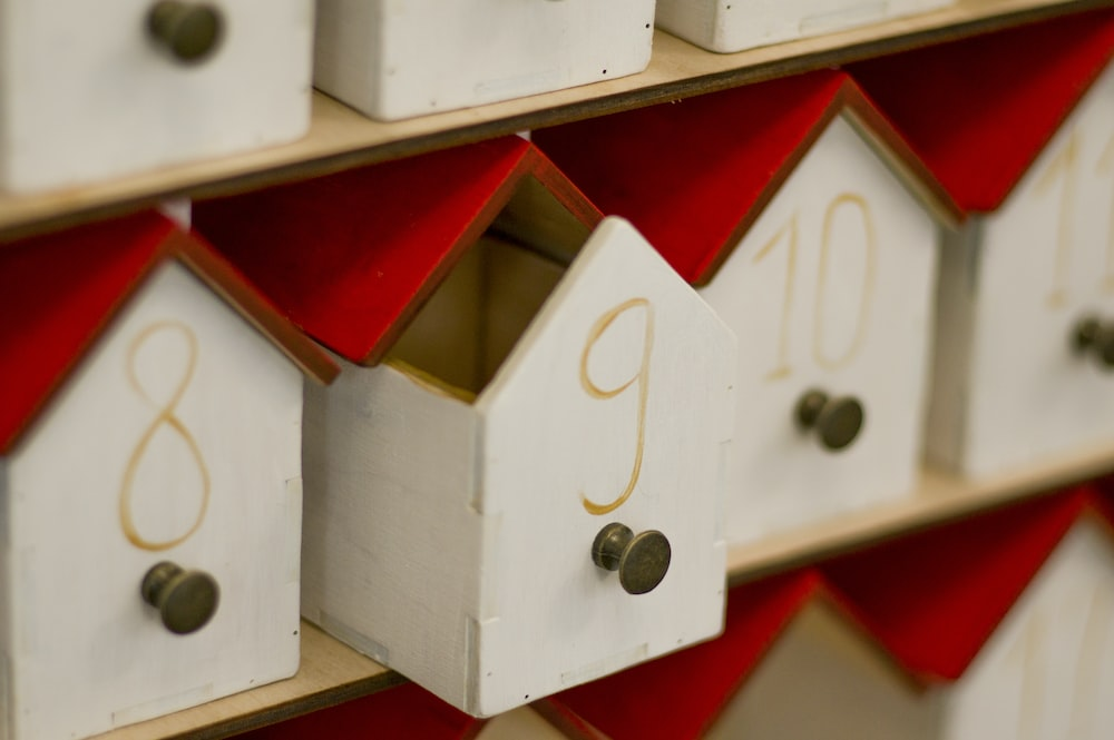 white and red wooden cube