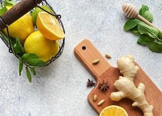 sliced lemon beside sliced lemon on chopping board