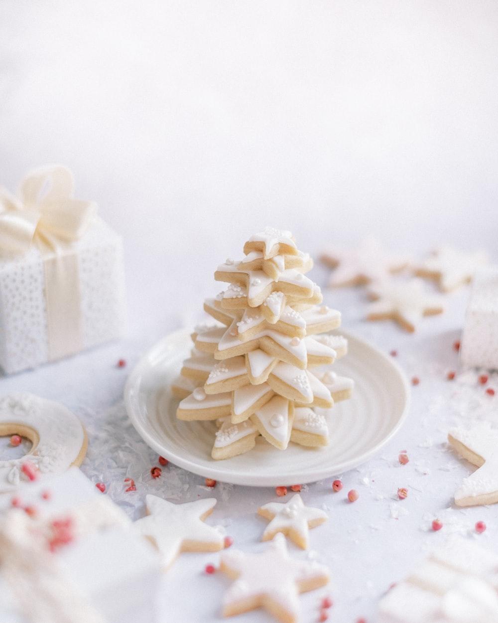 White star Christmas cookies on white ceramic plate