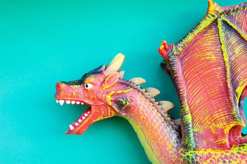 green and brown dragon figurine