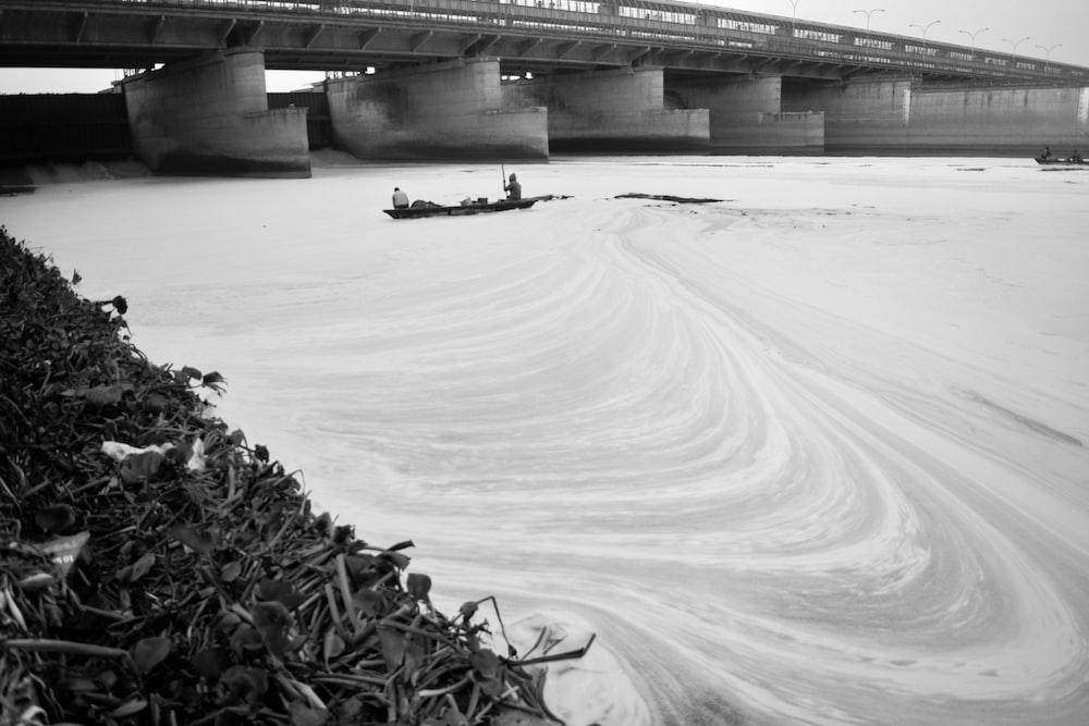 grayscale photo of bridge over river
