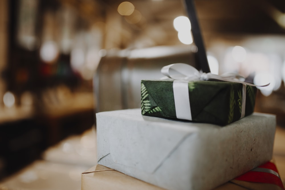 green and white tissue box on white table