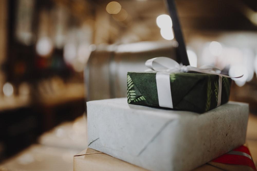 green and white tissue box on white table