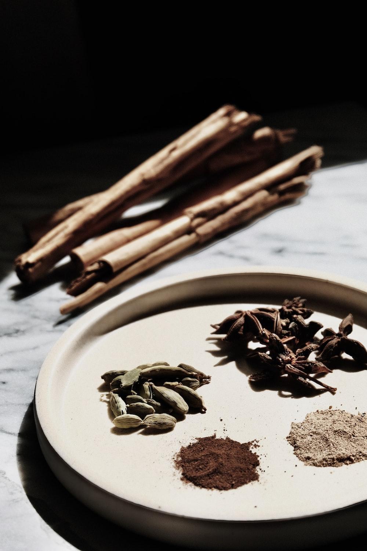 brown wooden sticks on white ceramic round plate