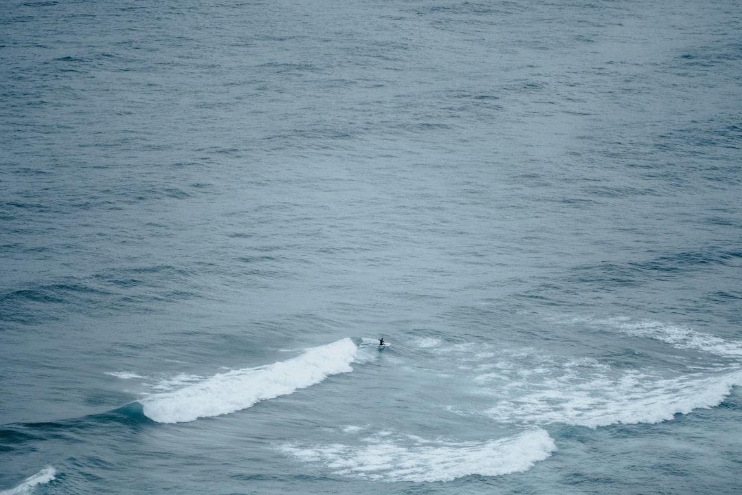 Person Surfing On Sea Waves During Daytime - unsplash