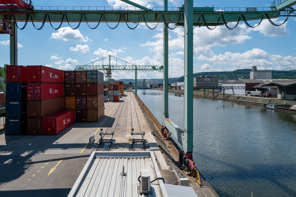 red cargo containers on dock during daytime