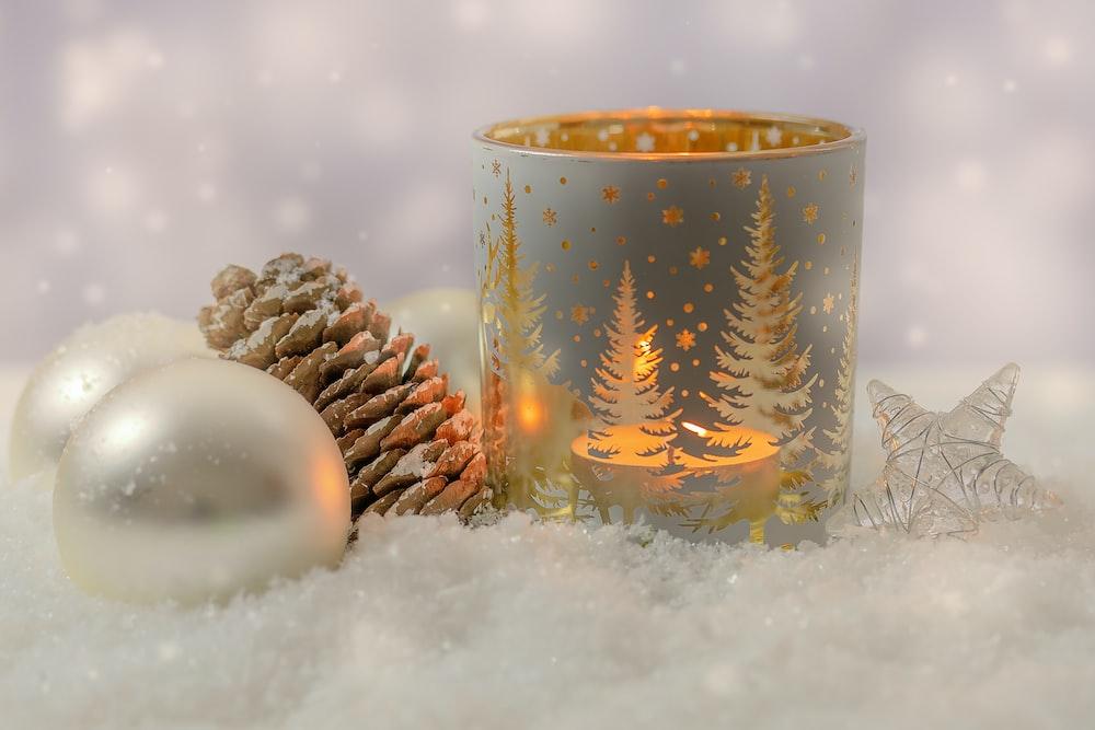white and gold ceramic mug on white snow