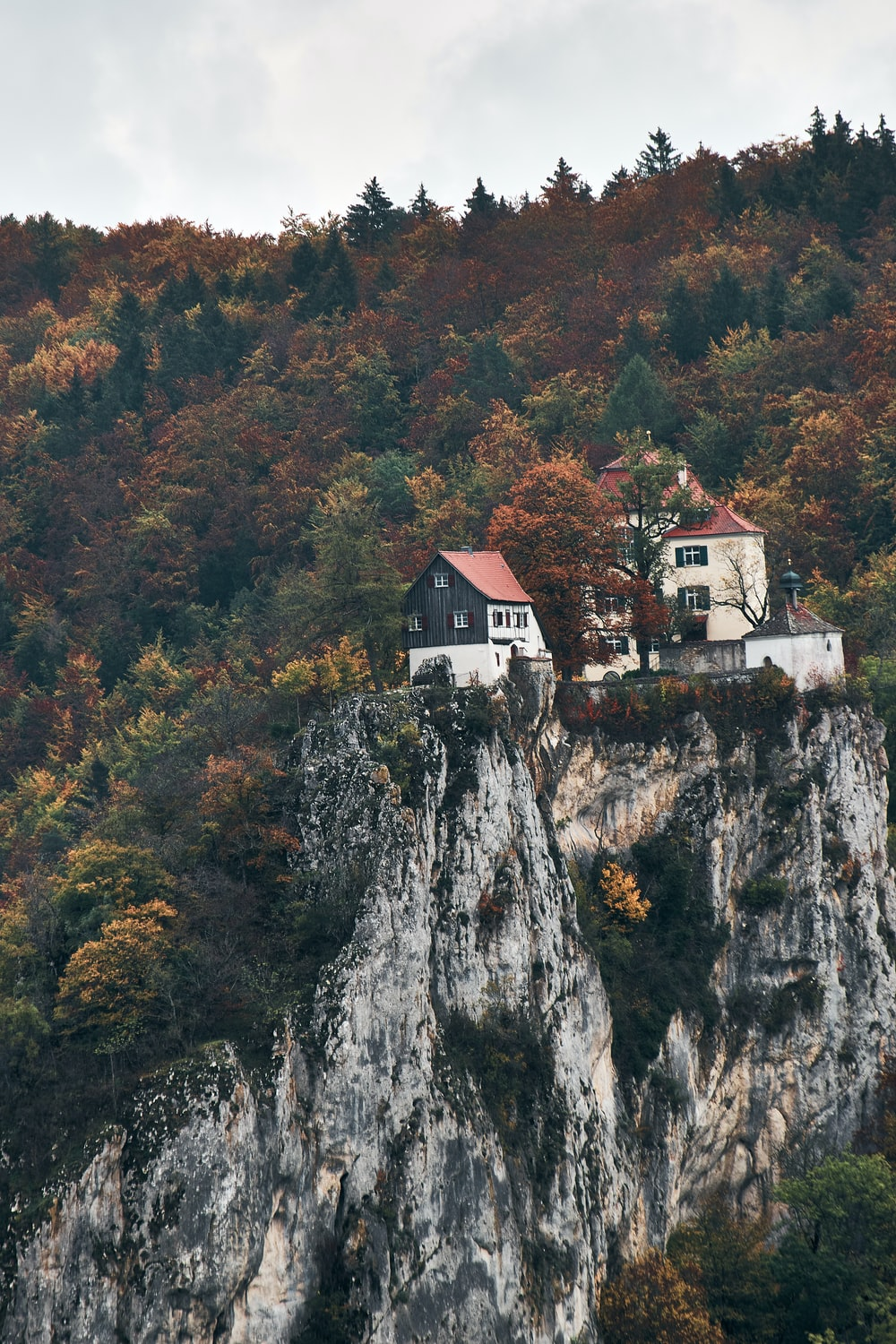 white and brown concrete house on top of mountain during daytime