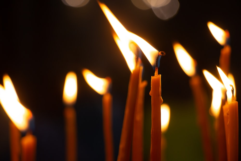 lighted candles in close up photography