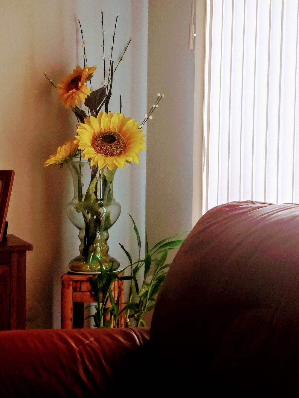 yellow flower in clear glass vase