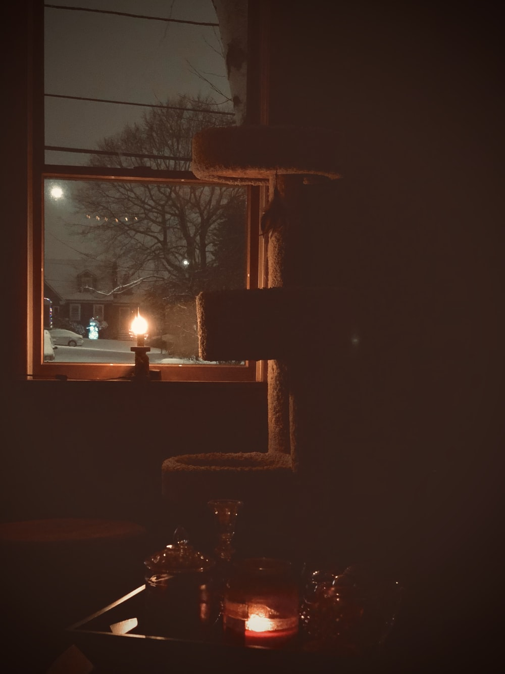 brown wooden window frame with white light