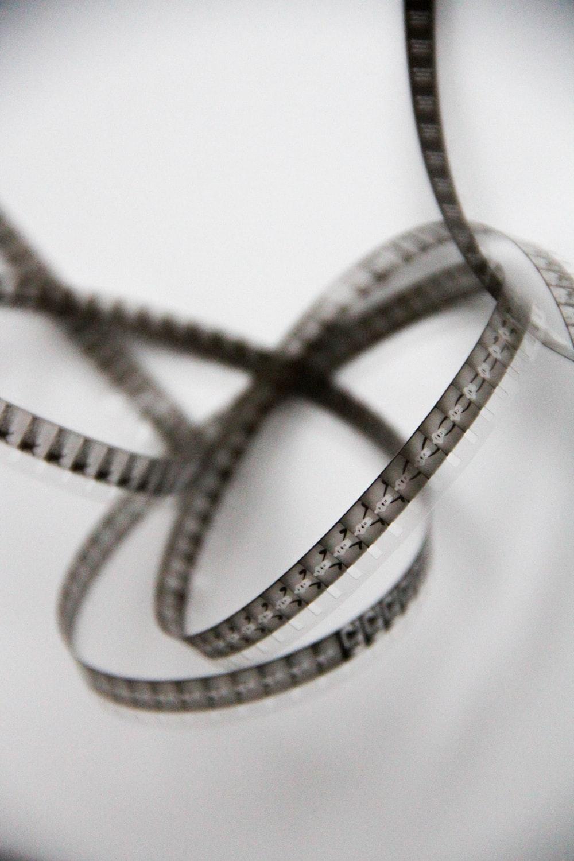 silver and diamond ring on white textile