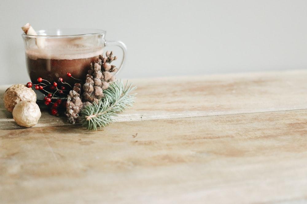 clear glass mug with brown liquid inside