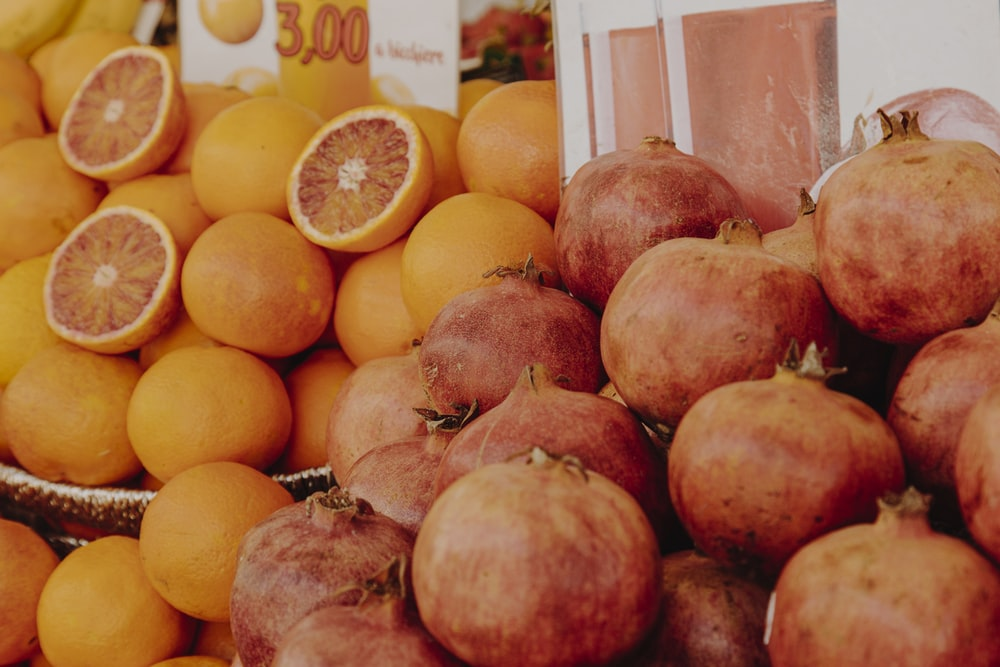 orange fruit and yellow round fruits
