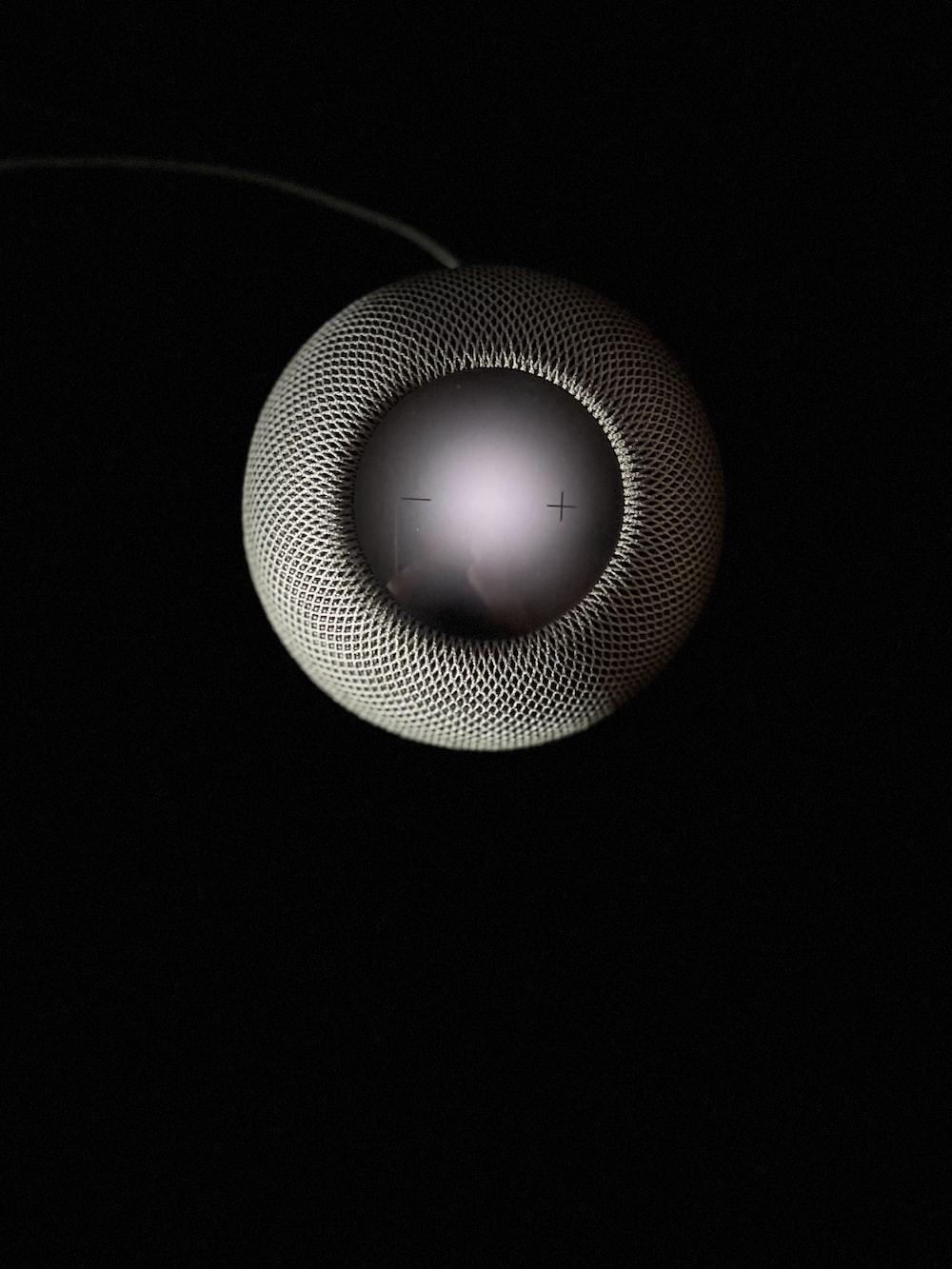 round white and black portable speaker