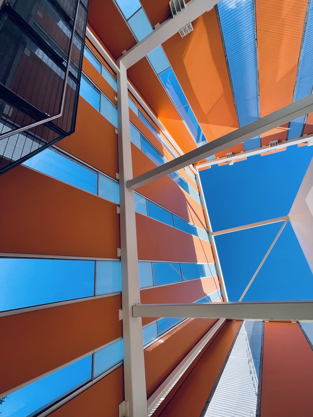 blue and orange glass walled building