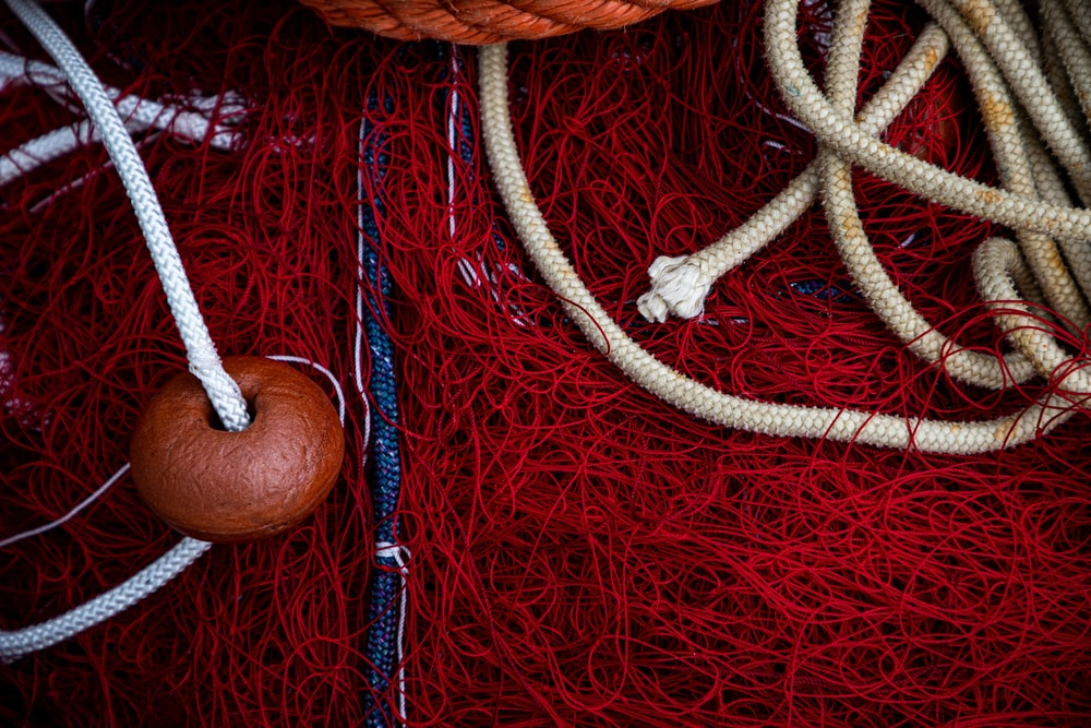 brown rope on red textile