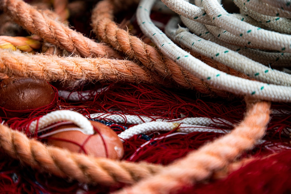 brown rope on blue and red rope