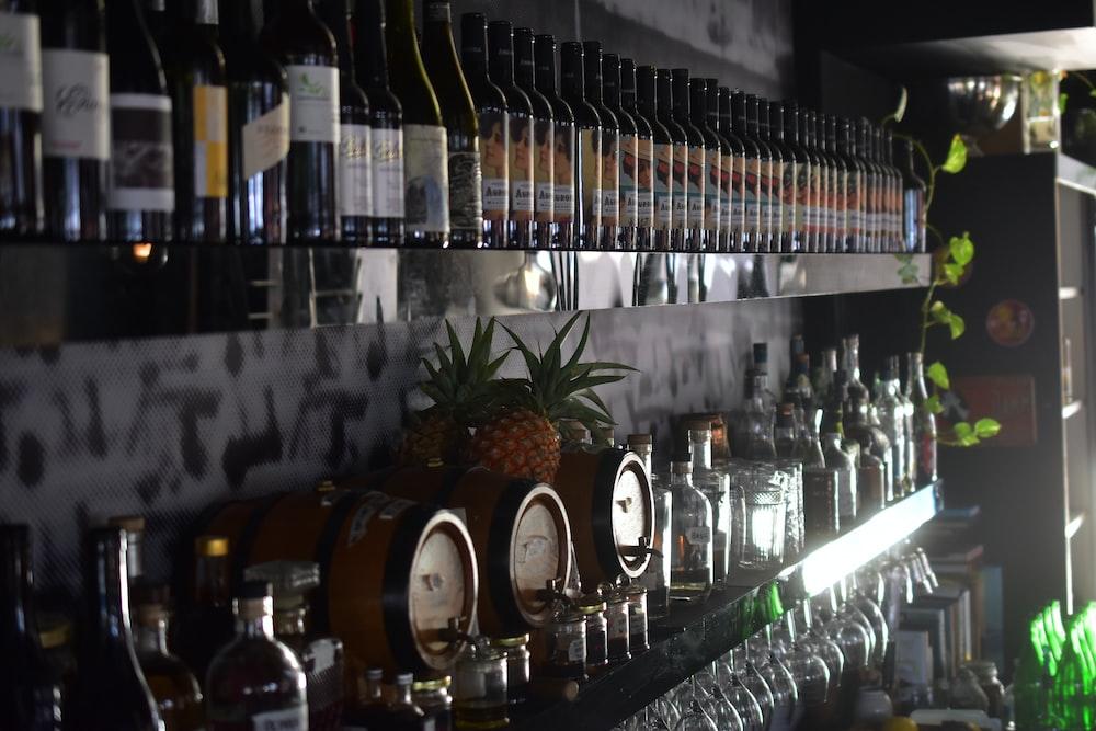 wine bottles on glass shelf