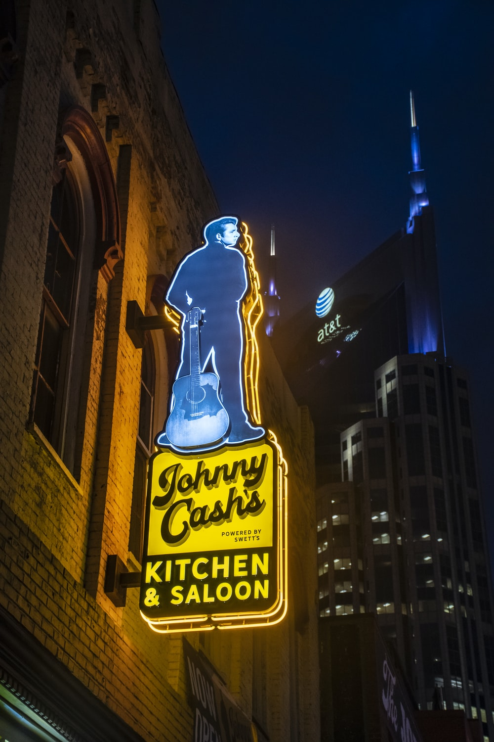 yellow and blue lighted signage
