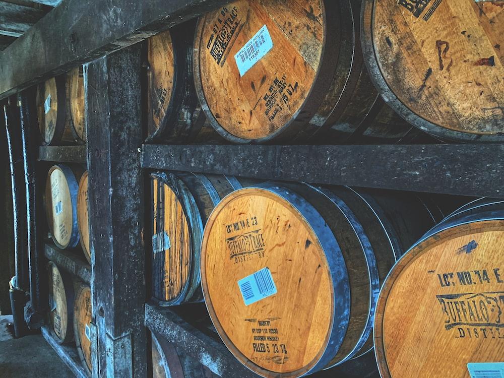 brown wooden barrels on wooden barrels