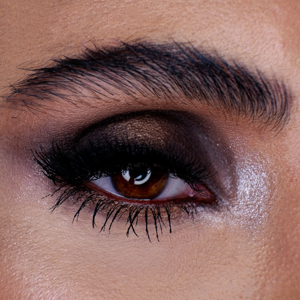 persons eye with black mascara