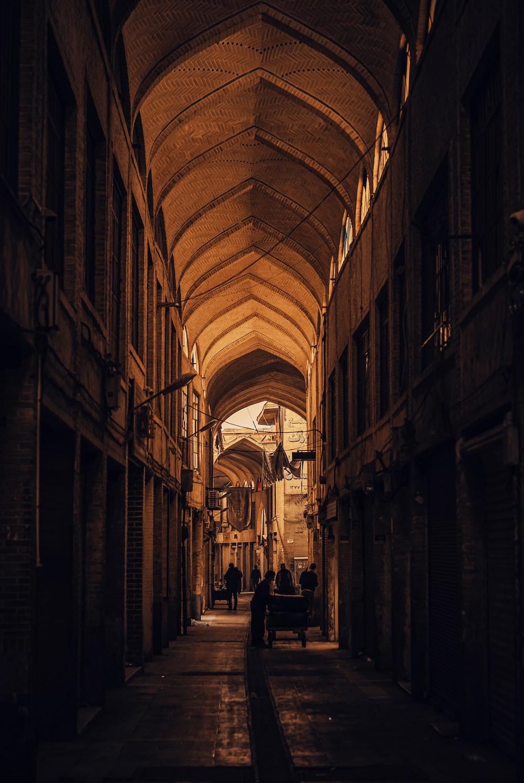 people walking in a hallway