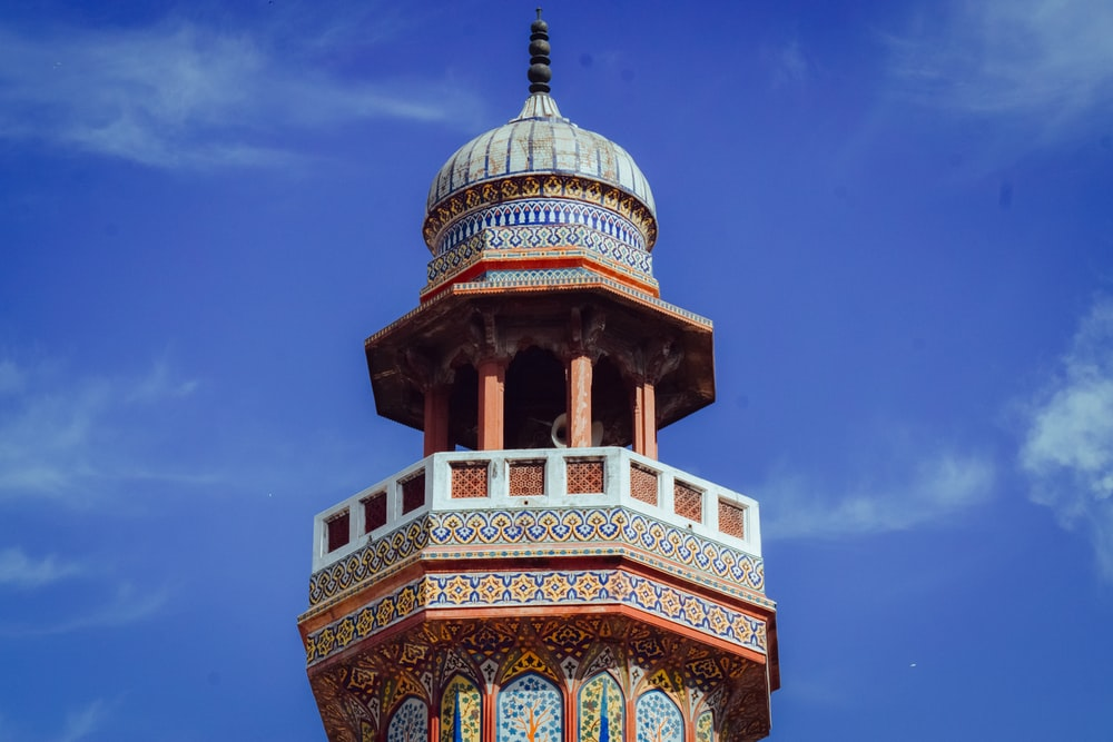 brown and green dome building under blue sky during daytime