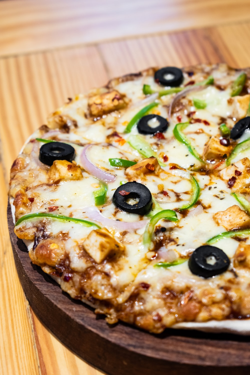 pizza with green and brown vegetable
