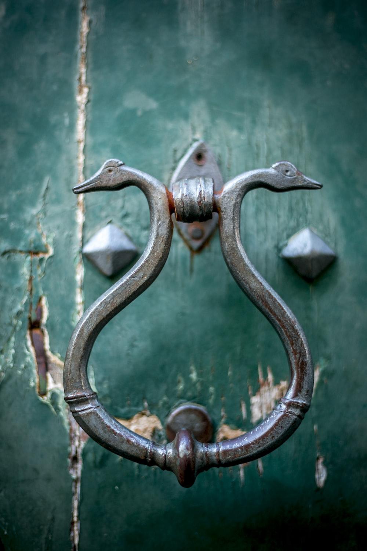 grey metal door handle bar