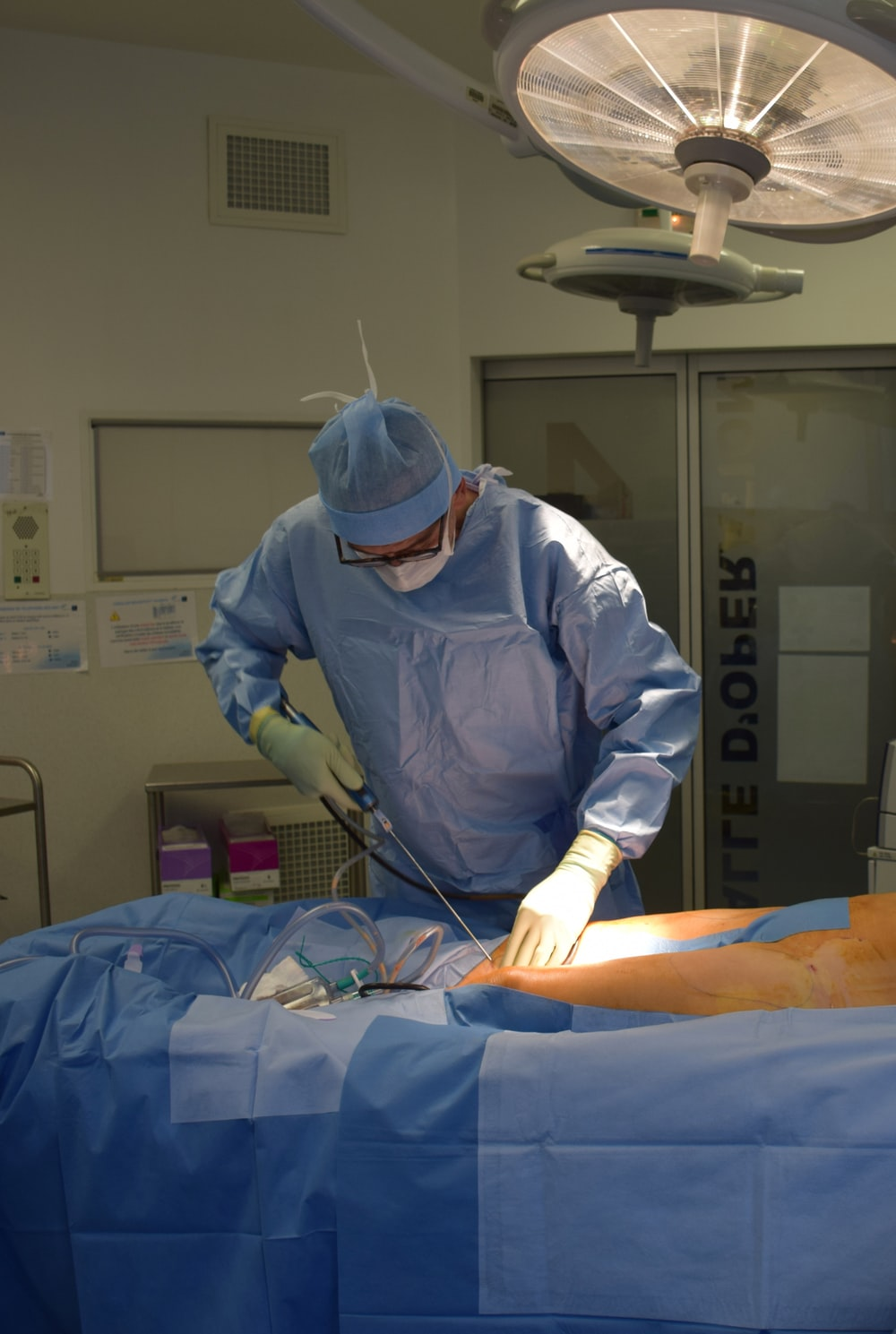 person in white medical scrub suit
