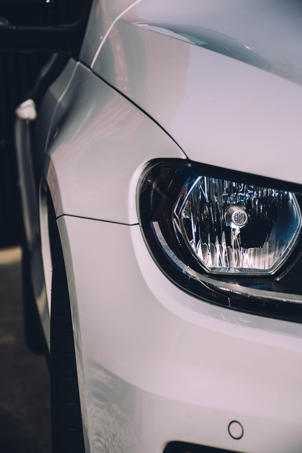 white car with silver headlight