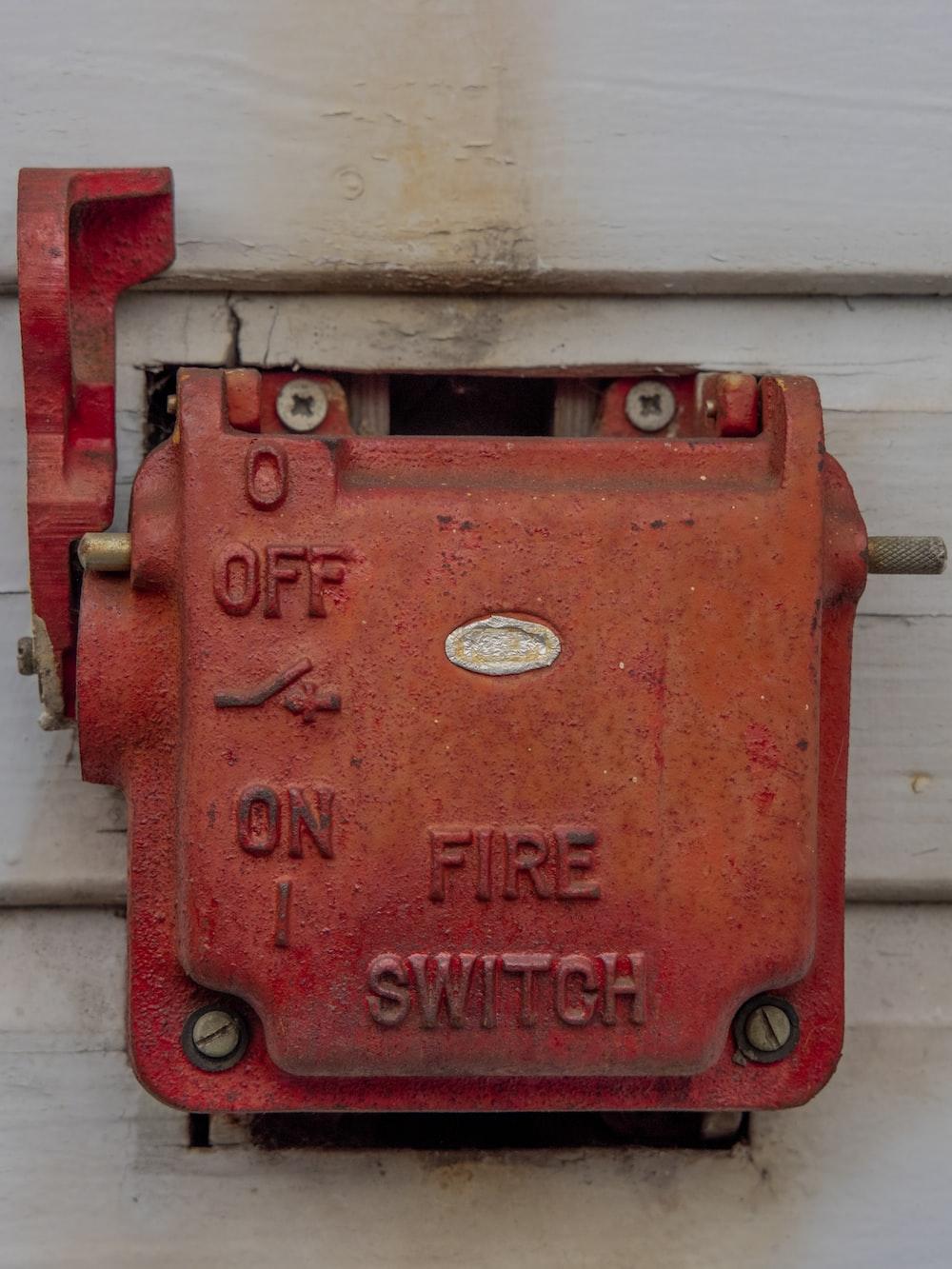 red metal door lock on white wooden wall