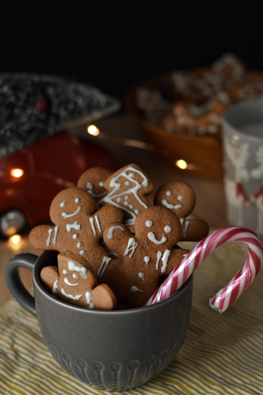 brown cookies in white ceramic mug