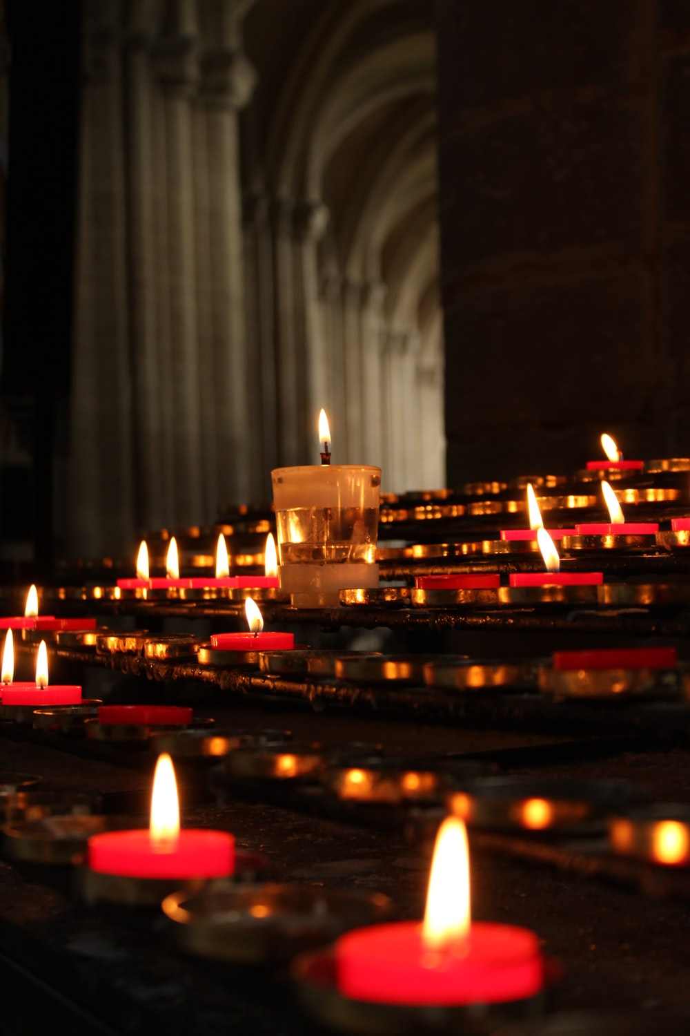lighted candles on black table