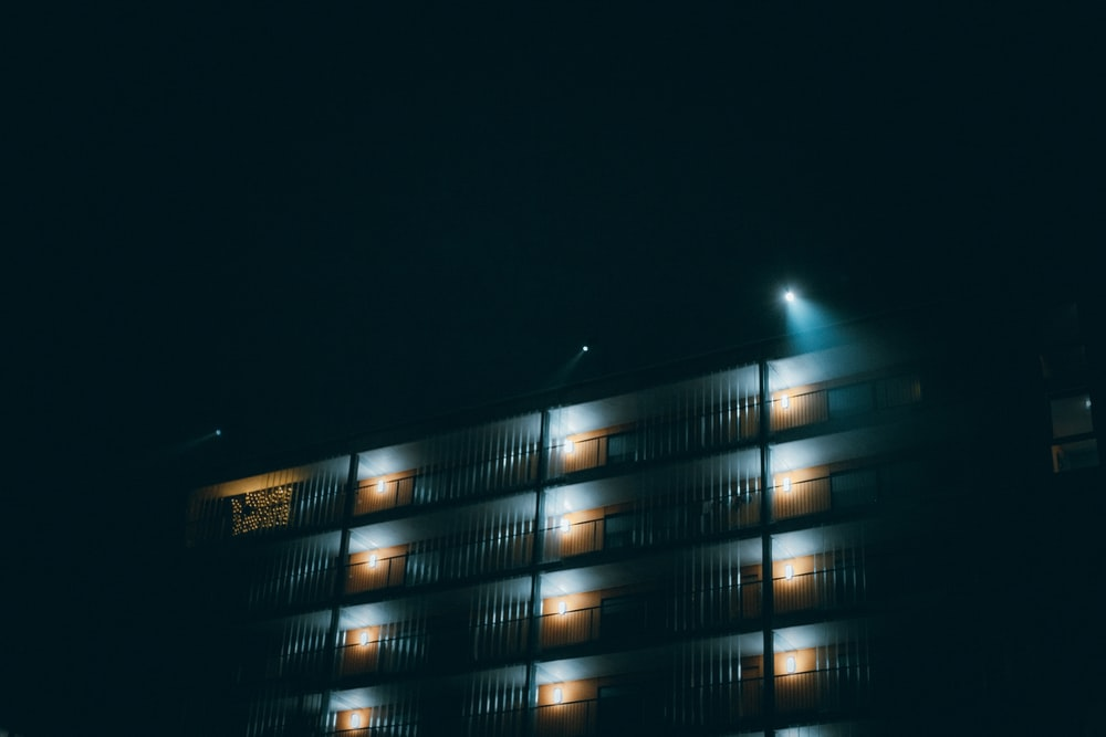 lighted high rise building during night time