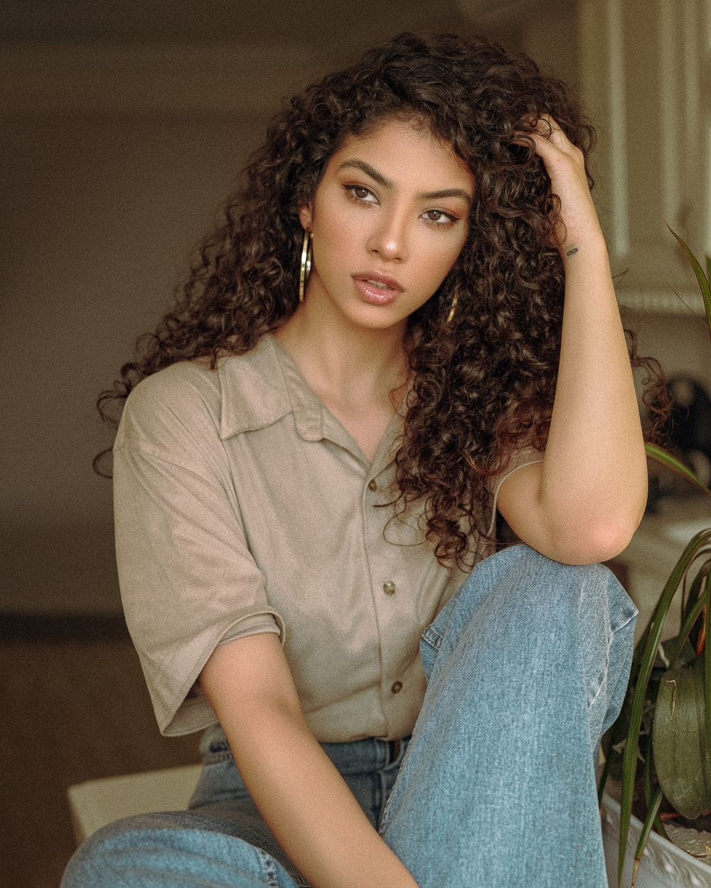 woman in brown button up shirt and blue denim jeans
