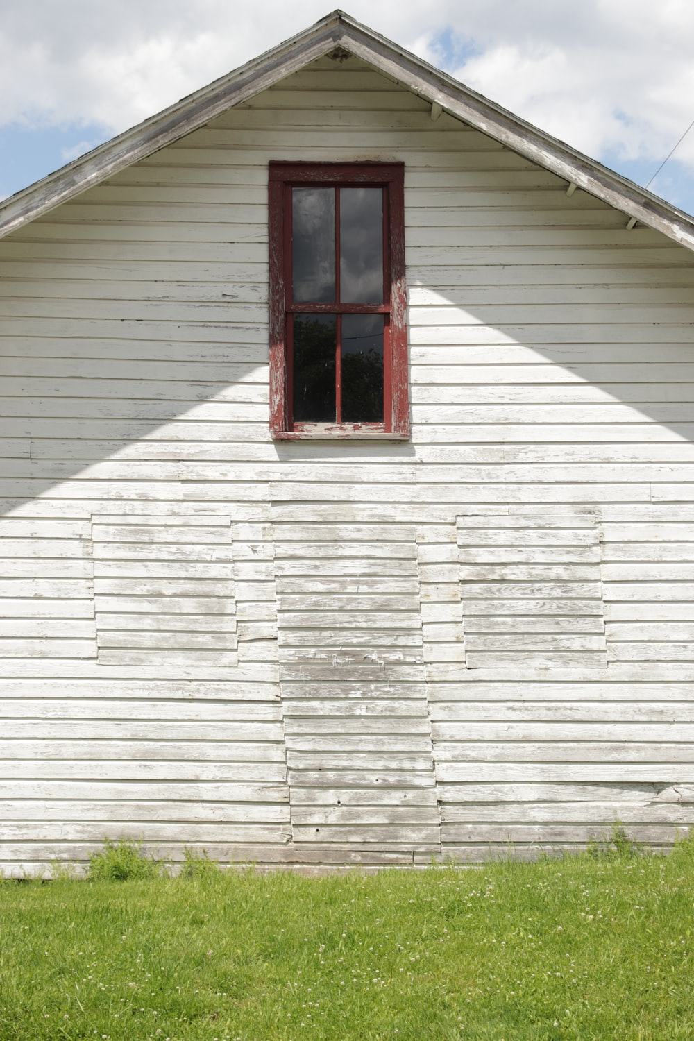 red wooden window on white wooden house