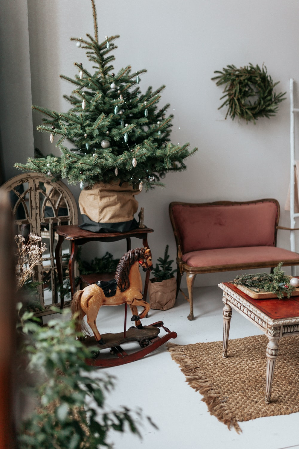 brown wooden armchair beside green christmas tree