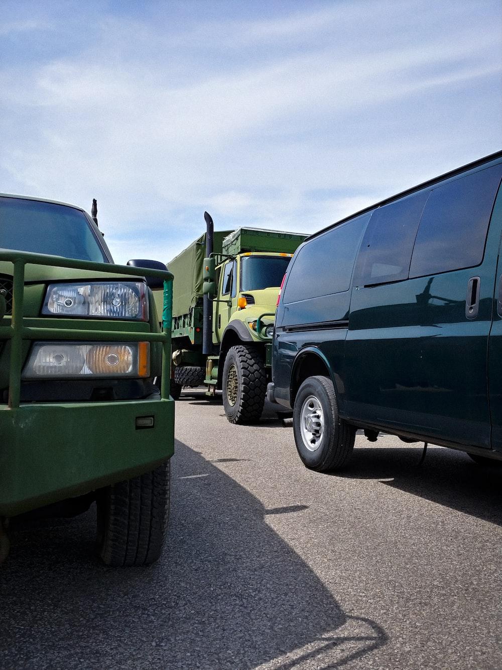 green and black van on gray asphalt road during daytime