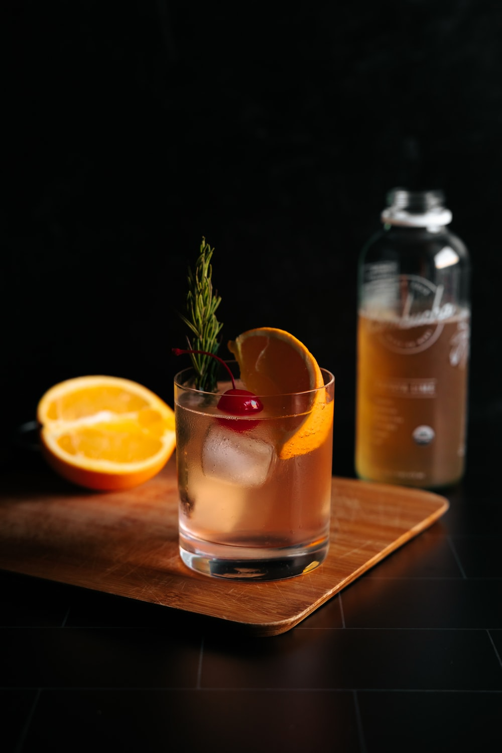 clear drinking glass with orange juice