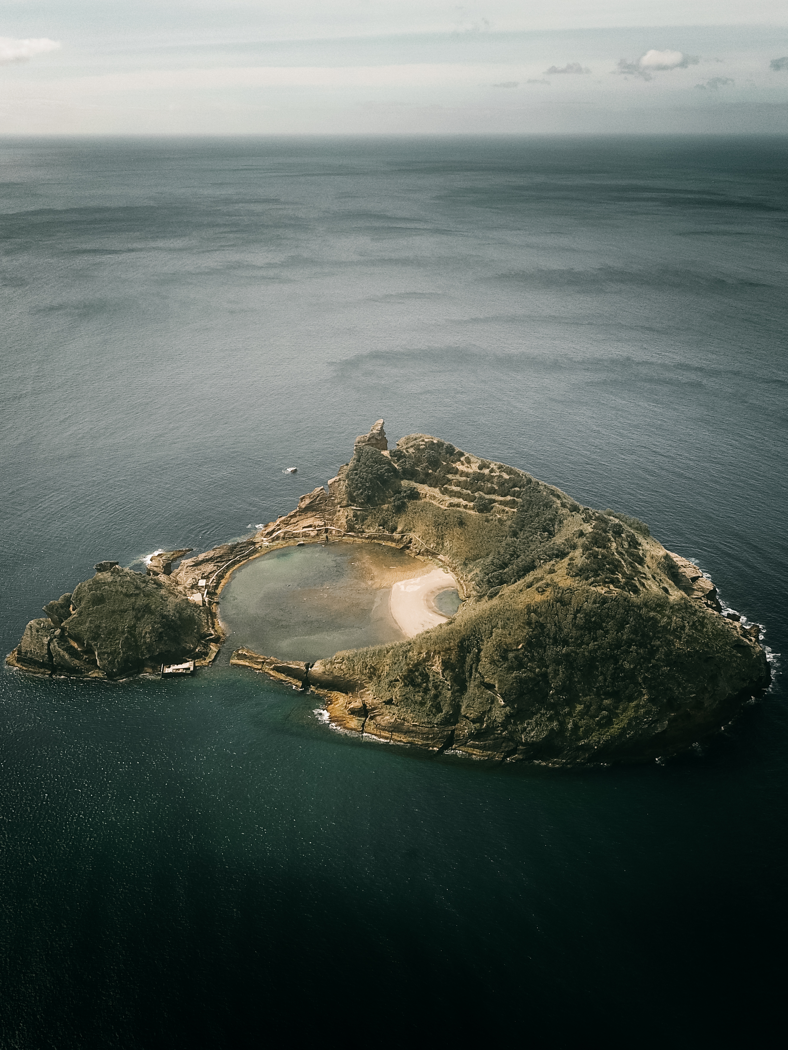 aerial view of island in the middle of ocean
