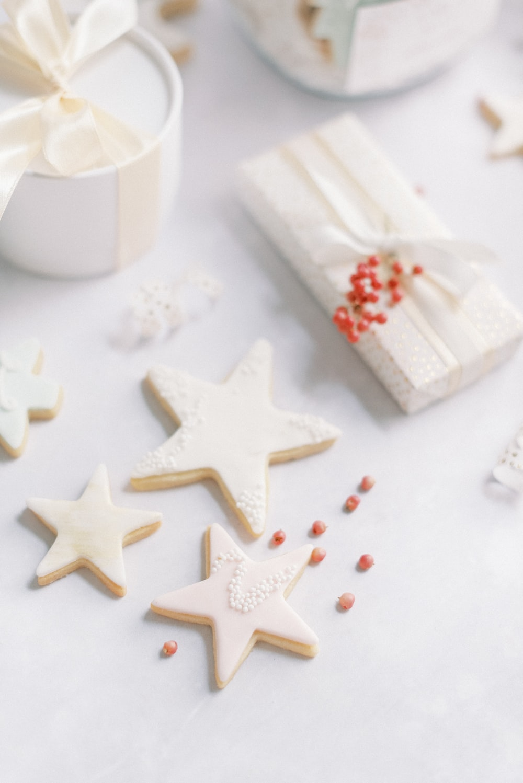 white ceramic mug beside white star ornament