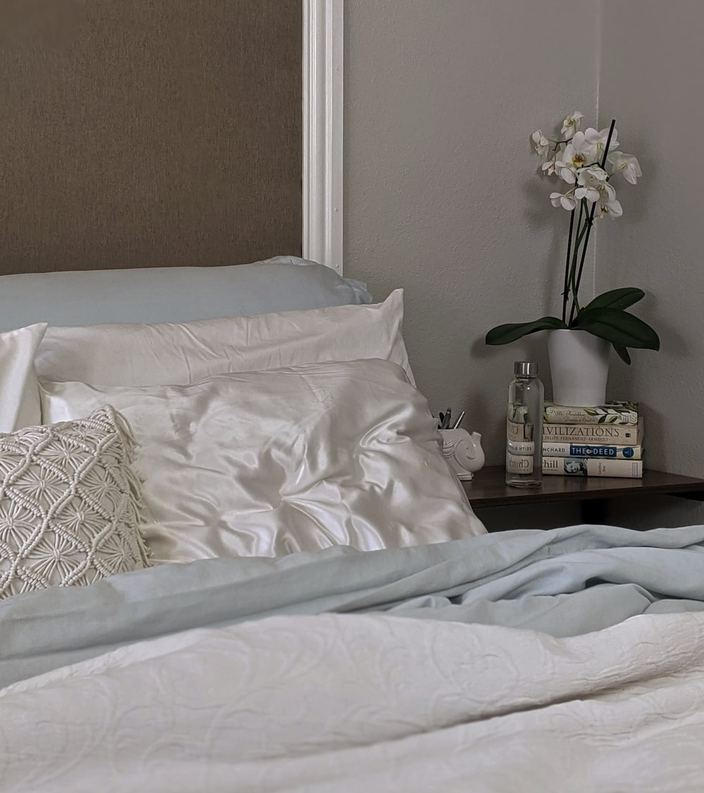white and gray floral bed linen