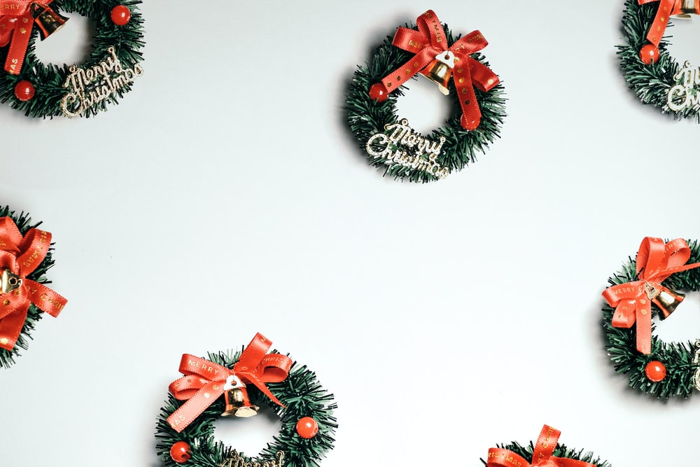 red and black pine cone wreath