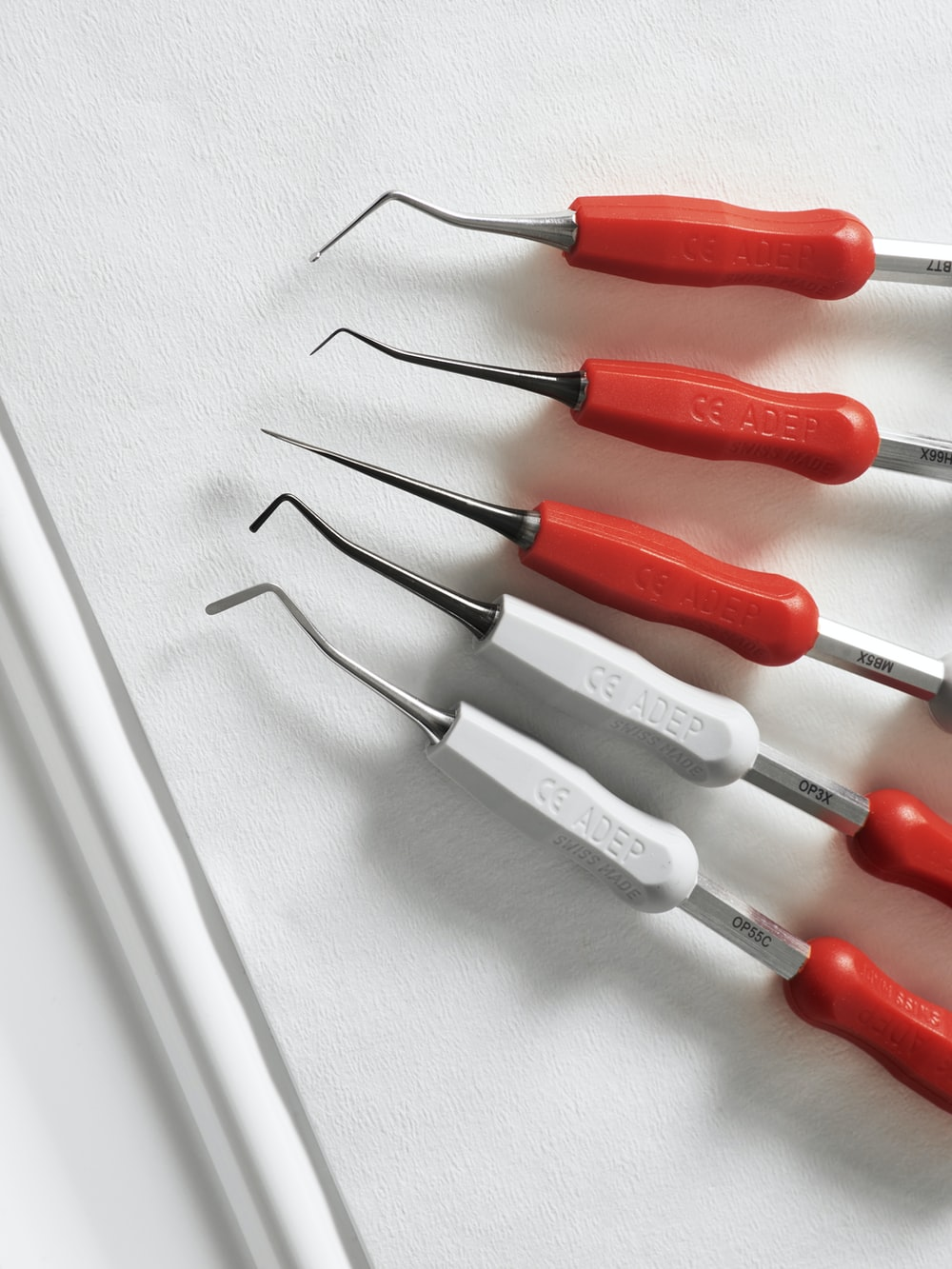 red and silver screw driver