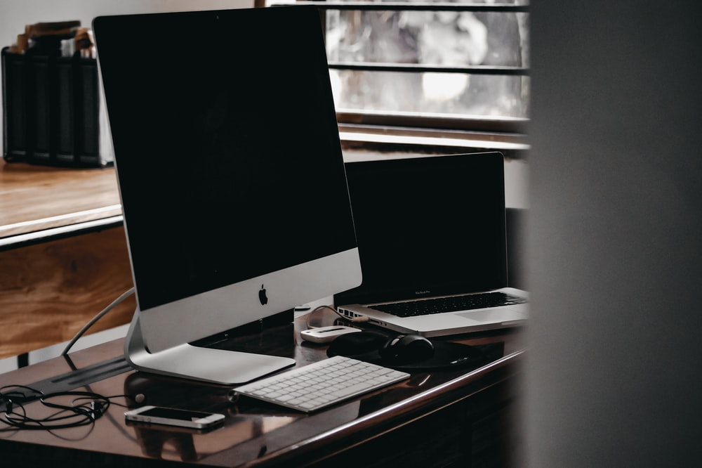 silver imac on black table