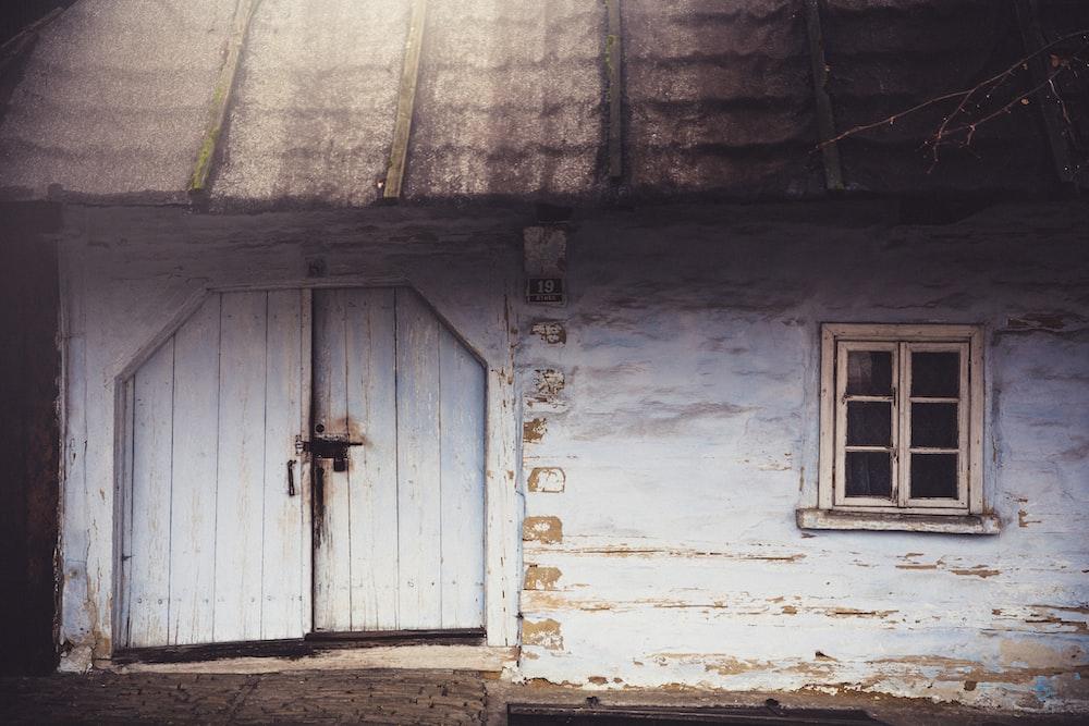 white wooden door with cross